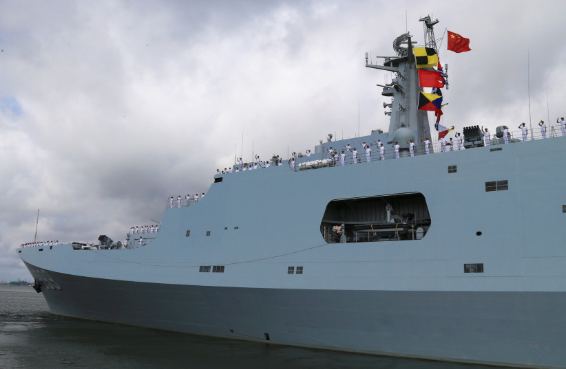 Soldiers of China's People's Liberation Army (PLA) salute from a ship sailing off from a military port in Zhanjiang, Guangdong province, July 11 (photo credit: HANDOUT)