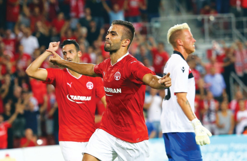 Hapoel Beersheba defender Miguel Vitor celebrates after scoring his team's opener in last night's 2-1 victory over Honved of Hungary in the first leg of the Champions League second qualifying round. (photo credit: UDI ZITIAT)