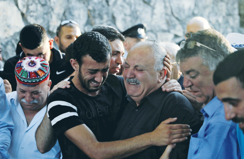 THE FAMILY OF Border Police officer Kamil Shnaan attend his funeral in Hurfeish, near the Lebanese border, on Friday. (photo credit: REUTERS)