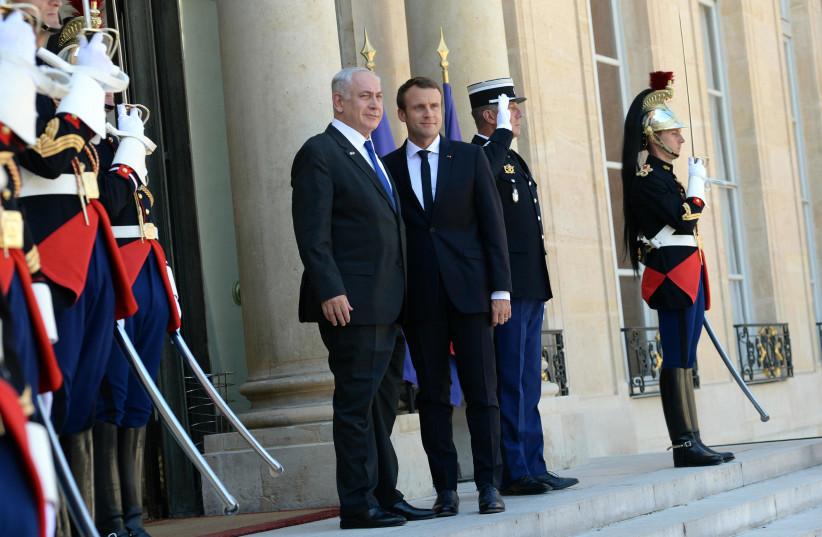 Benjamin Netanyahu and Emmanuel Macron (photo credit: GOVERNMENT PRESS OFFICE)