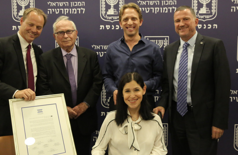 MKs Karin Elharrar and Roi Folkmann (center) win the Israel Democracy Institute's Outstanding Parliamentarian Award, July 17, 2017 (photo credit: ODED ANTMAN)