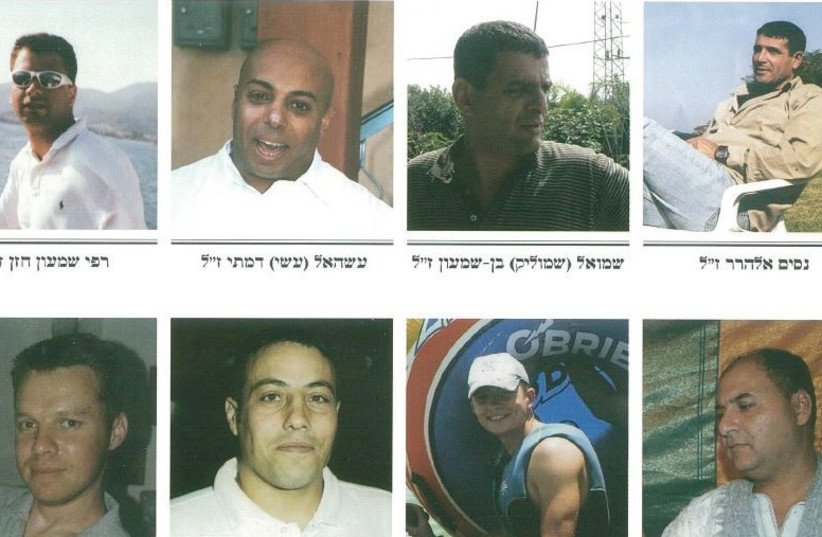 THESE EIGHT MEN were killed on July 16, 2006, when a Hezbollah rocket struck the Haifa train depot. From top left: Rafi Hazan, Asael Damti, Shmuel Ben-Shimon and Nissim Elharrar, and from bottom left: David Feldman, Shlomi Mansoura, Dennis Lapidus and Reuven Levi. (photo credit: ISRAEL RAILWAYS)