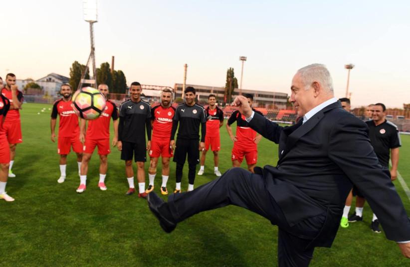 Prime Minister Benjamin Netanyahu visits a soccer practice in Hungary (photo credit: PMO)