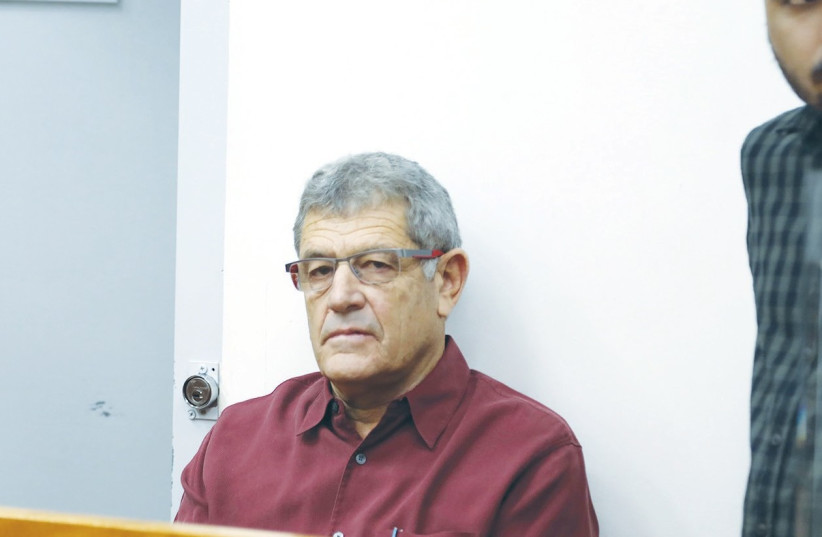 MIKI GANOR, ThyssenKrupp's representative in Israel, waits at the Rishon Lezion Magistrate's Court on Tuesday. (photo credit: AVSHALOM SASSONI/MAARIV)