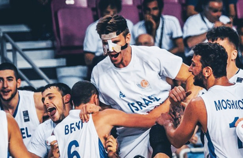 Israel players celebrate yesterday after advancing to the under-20 European Championship final in Crete, Greece. (photo credit: Courtesy)