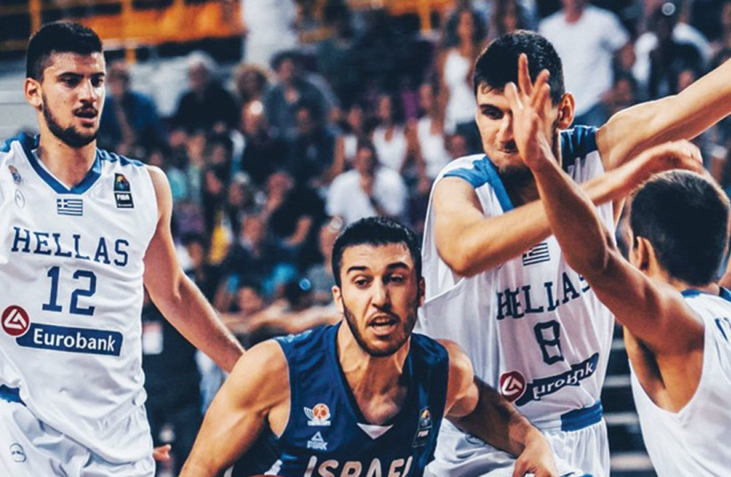 Israel guard Tamir Blatt (center) was shut down by the Greek defense in last night's 65-56 loss to the hosts in the final of the under-20 European Championship. (photo credit: FIBA EUROPE WEBSITE)