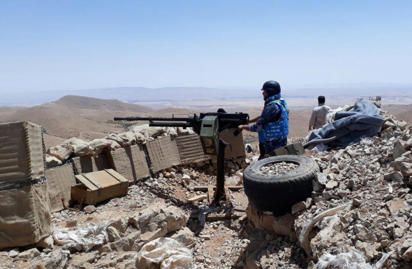 Fighters from the Syrian army units and Hezbollah are seen on the western mountains of Qalamoun, near Damascus, in this handout picture provided by SANA (photo credit: SANA/REUTERS)
