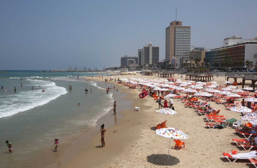 Tel Aviv beach in the summer. (photo credit: MARC ISRAEL SELLEM)