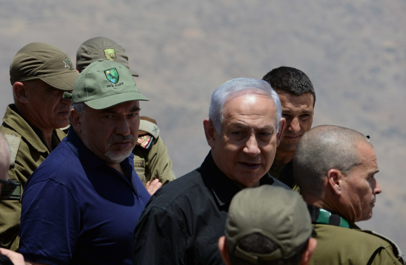 Defense Minister Avigdor Liberman and Prime Minister Benjamin Netanyahu in a tour of Mt. Hermon and Golan IDF positions. (photo credit: DEFENSE MINISTRY)