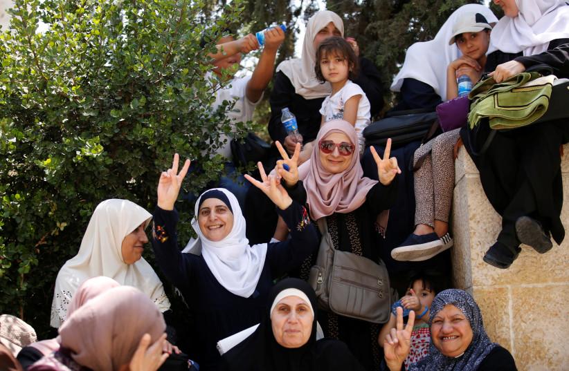 Palestinian women celebrate outside Temple Mount in Jerusalem (photo credit: AMIR COHEN - REUTERS)
