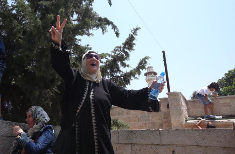Palestinian women celebrate outside Temple Mount in Jerusalem (photo credit: MARC ISRAEL SELLEM)