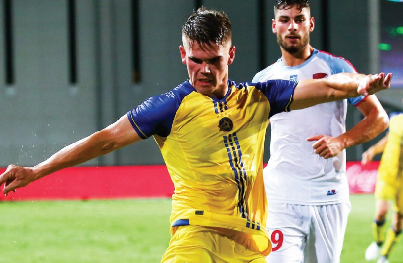 Maccabi Tel Aviv striker Vidar Orn Kjartansson netted his team's only goal with this shot in last night's 1-0 win over Panionios in Netanya in the first leg of the Europa League third qualifying round (photo credit: DANNY MAROM)