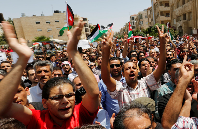 Protestors chanting slogans during a demonstration near the Israeli embassy in Amman, Jordan July 28, 2017.  (photo credit: REUTERS)