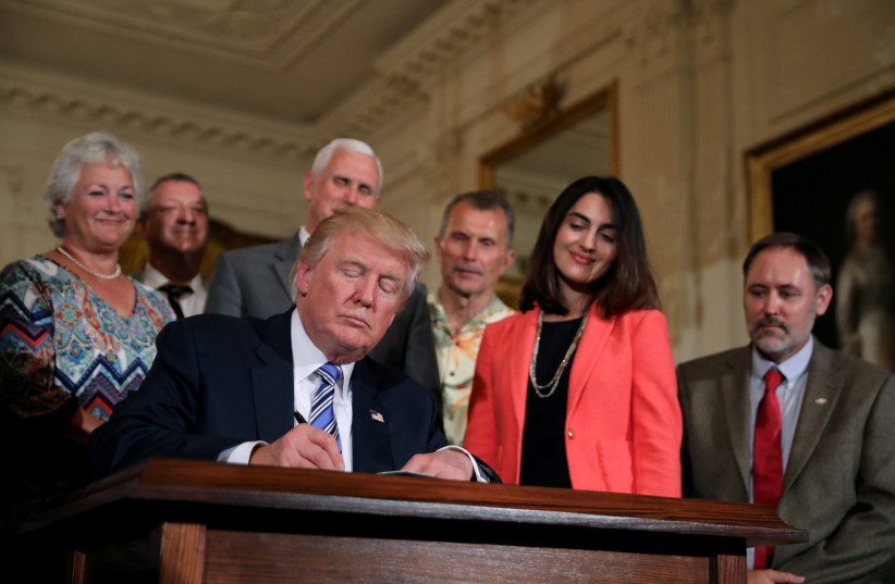 US President Donald Trump signs a proclamation, July 17, 2017. (photo credit: REUTERS/CARLOS BARRIA)