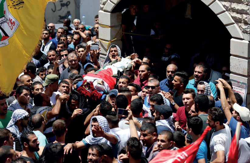 MOURNERS CARRY the body of Palestinian Bara Hamamdah (photo credit: REUTERS)