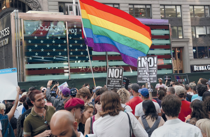 PEOPLE PROTEST US President Donald Trump's ban on transgender service members in the military. (photo credit: REUTERS)