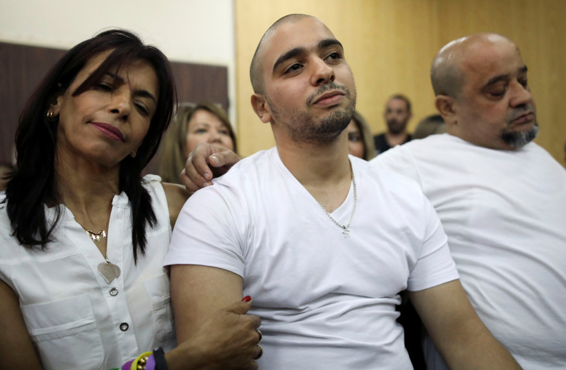 Former Israeli soldier Elor Azaria and his family await a ruling on the appeal of his manslaughter conviction (photo credit: REUTERS/DAN BALILTY)