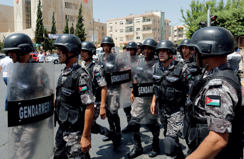 JORDANIAN POLICE deployed during protests against Israel in Amman. (photo credit: REUTERS)