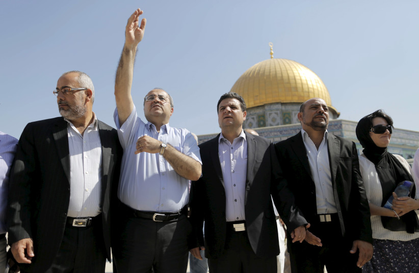 Israeli Arab lawmakers from the Joint Arab List (from L to R) Osama Saadi, Ahmed Tibi, Ayman Odeh, Masud Ganaim and Haneen Zoabi stand in front of the Dome of the Rock during a visit to the Temple Mount in Jerusalem's Old City July 28, 2015.  (photo credit: REUTERS)