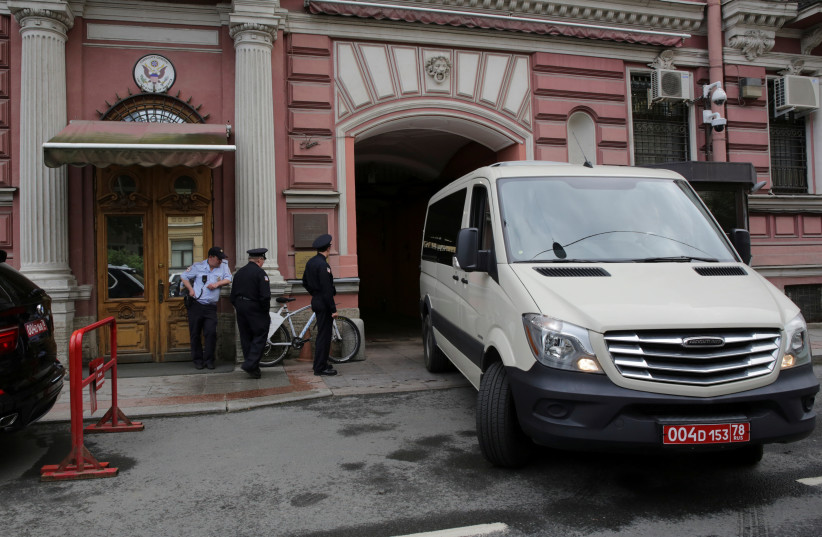 Security officers watch a consulate car entering the US consulate in St. Petersburg, Russia (photo credit: REUTERS/ANTON VAGANOV)