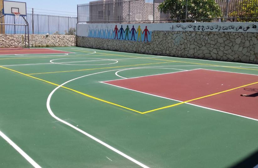 New basketball court at a Haifa school, July 2017. (photo credit: REUVEN COHEN/ HAIFA MUNICIPALITY)