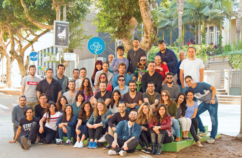 MEMBERS OF the dapulse team. The Israeli start-up has designed a web and mobile app that builds collaboration and transparency in the workplace (photo credit: Courtesy)