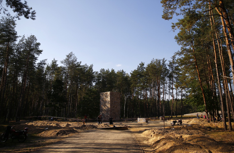 Archaeologists dig in the perimeter of a Nazi death camp (photo credit: KACPER PEMPEL / REUTERS)
