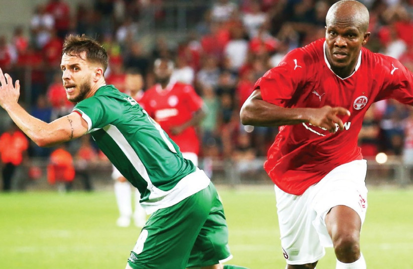 Hapoel Beersheba 's Nigerian forward Anthony Nwakaeme (right) has so far carried the team in Champions League qualification and will aim to keep it on track to reach the group stage when it visits Bulgarian champion Ludogorets tonight holding a 2-0 lead from the first leg.  (photo credit: DANNY MAROM)