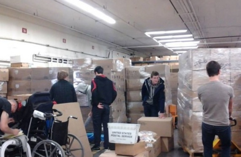 Photos of containers of aid being prepared in the US (photo credit: COURTESY OF THE MUTLIFAITH ALLIANCE)