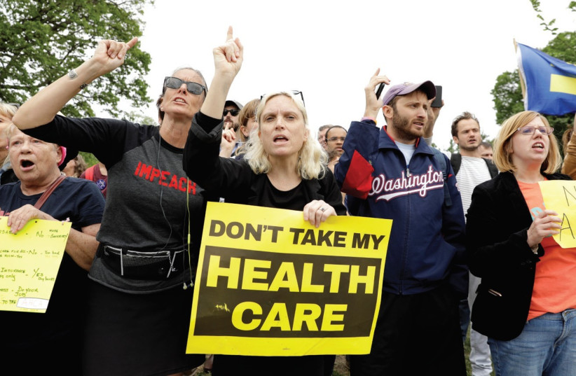 DEMONSTRATORS PROTEST in front of Washington's US Capitol (photo credit: REUTERS)