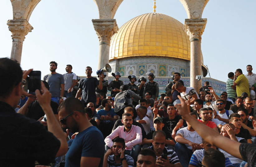 Protestors at the Temple Mount (photo credit: REUTERS)