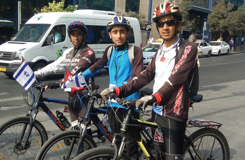 From left: Nirmal Baral, Anish Dhakel and Dilip Chhetri arrive by bicycle at the Jerusalem Central Bus Station last week. (photo credit: YAKIR FELDMAN)