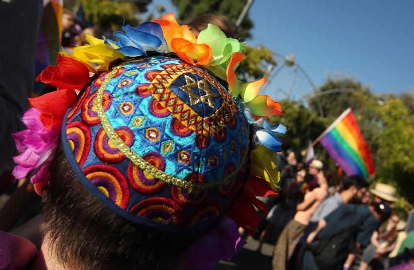 Boy wearing a colorful kippah at the Jerusalem Gay Pride Parade 2017 (photo credit: MARC ISRAEL SELLEM)