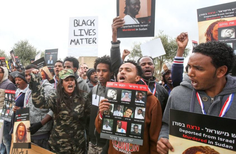 Sudanese and Eritreans in Israel protest their treatment in front of the Knesset (photo credit: MARC ISRAEL SELLEM/THE JERUSALEM POST)