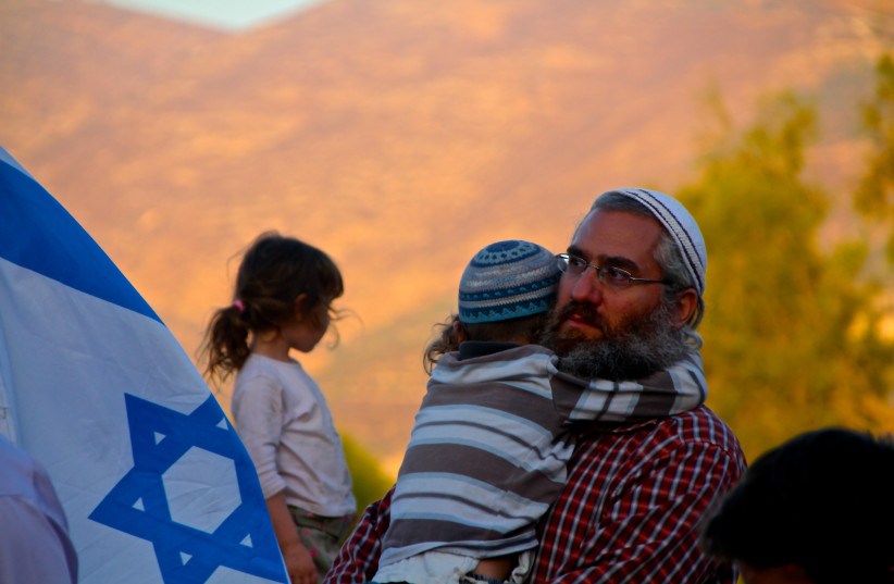 Settlers at a protest rally on the ruins of the Sa-Nur settlement in Samaria (photo credit: TOVAH LAZAROFF)