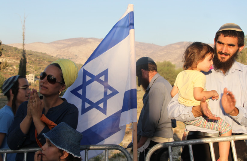 Settlers at a protest rally on the ruins of the Sa-Nur settlement in Samaria. (photo credit: TOVAH LAZAROFF)