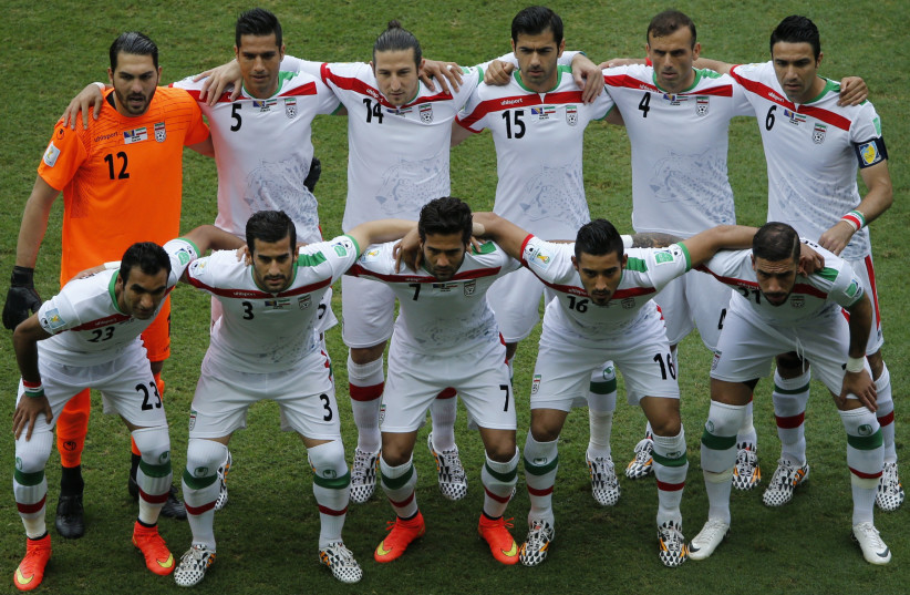 Iran's national soccer players pose for a team photo during the 2014 World Cup (photo credit: REUTERS)