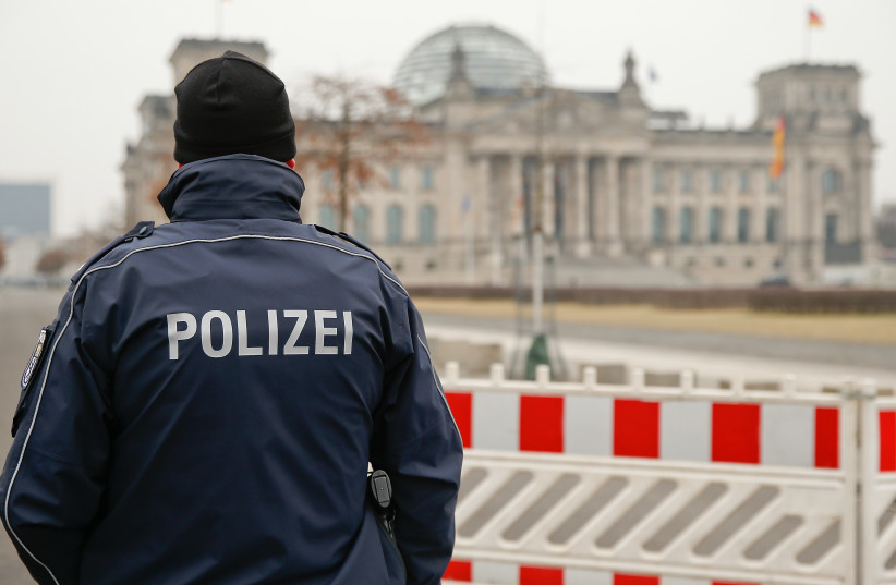 German police guard the Reichstag building, the seat of the German lower house of parliament Bundestag, before the German presidential election in Berlin, February 12, 2017 (photo credit: REUTERS)