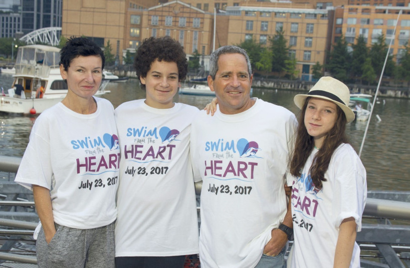 GUY COHEN before the race, with partner Sigal and their children, Matan and Noa. (photo credit: JUDAH S. HARRIS)