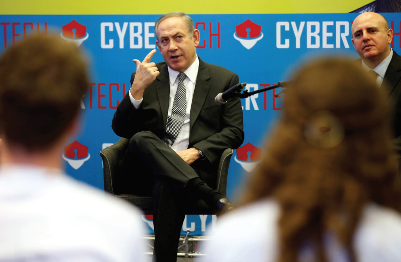 PRIME MINISTER Benjamin Netanyahu speaks to students involved in high-tech related programs during a Cyber Security Conference in Tel Aviv in January. (photo credit: REUTERS)