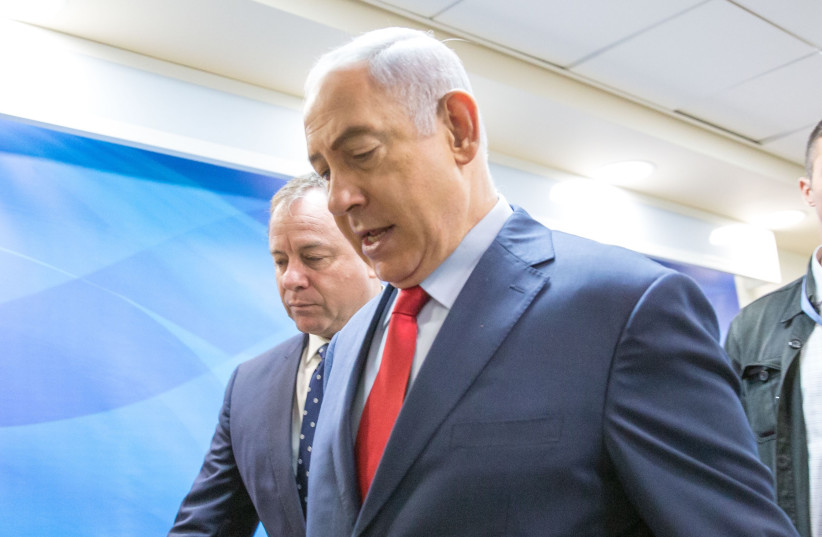 Prime Minister Netanyahu enters a meeting of the security cabinet, August 2017 (photo credit: MARC ISRAEL SELLEM/THE JERUSALEM POST)