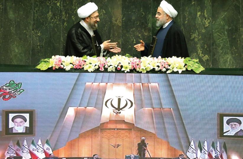 Hassan Rouhani (right) and Sadeq Larijani (left) at the parliament in Tehran Iran (photo credit: REUTERS)