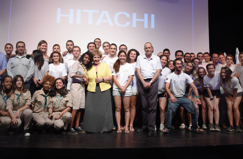 Minister of Aliyah and Integration MK Sofa Landver (Yisrael Beiteynu) poses with new IDF volunteers. (photo credit: DEFENSE MINISTRY)