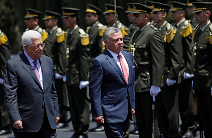 Jordan's King Abdullah II and Palestinian Authority President Mahmoud Abbas review the honour guard during a reception ceremony in the West Bank city of Ramallah, August 7, 2017 (photo credit: REUTERS)