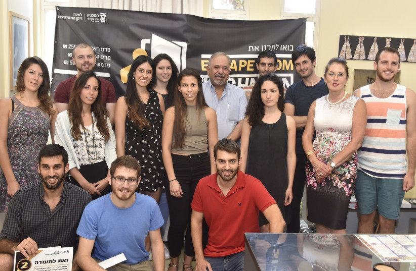 The winners of the Technion Escape Room challenge pose with Dean of Students Prf. Benny Natan (photo credit: TECHNION)