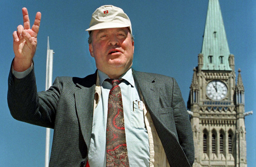 File photo of Holocaust denier Ernst Zundel leaving a news conference on the steps of Parliament Hill in Ottawa, June 5, 1998. Zundel was deported to Germany March 1, 2005, after a Federal Court judge found Zundel a threat to national security because of his connection with white supremacist and neo (photo credit: REUTERS)