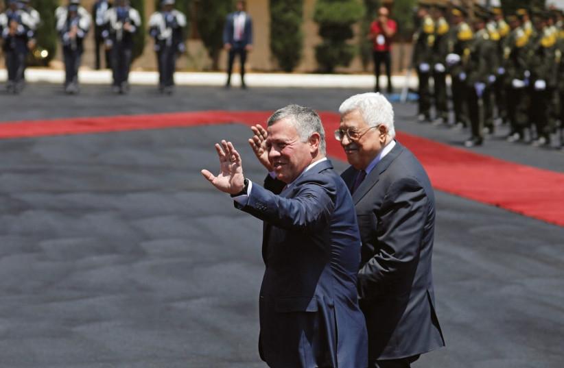 JORDAN'S KING Abdullah II and Palestinian Authority President Mahmoud Abbas (photo credit: MOHAMAD TOROKMAN/REUTERS)