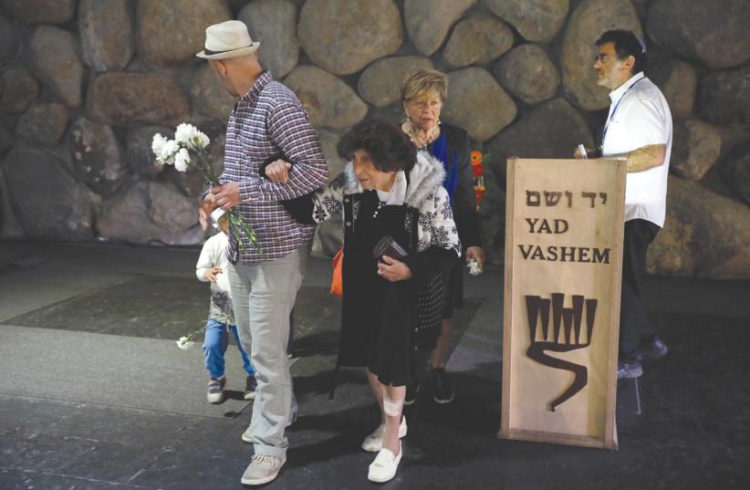 HOLOCAUST SURVIVOR Bella Avner and her family  (photo credit: AMIR COHEN - REUTERS)