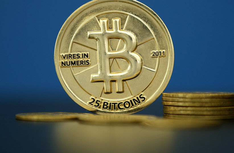 Bitcoin, the world's most famous cryptocurrency (photo credit: BENOIT TESSIER /REUTERS)