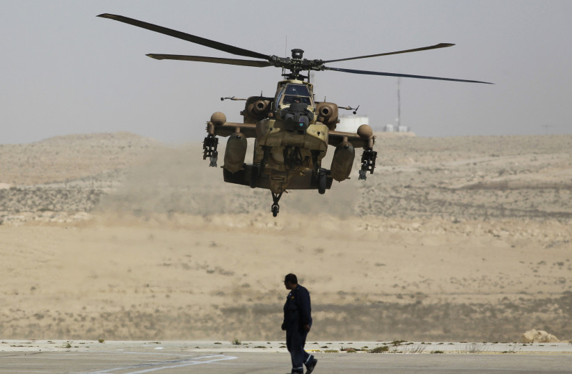 Israeli Apache helicopter lands at Ramon air base (photo credit: AMIR COHEN - REUTERS)